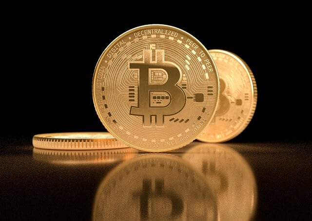 Golden Coin BTC black background