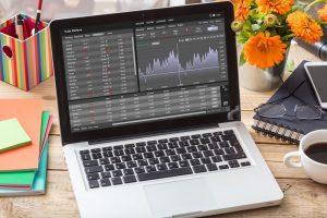 Quantum AI trade platform, forex trading. Stock exchange market analysis, monitoring app on laptop screen, office desk background.